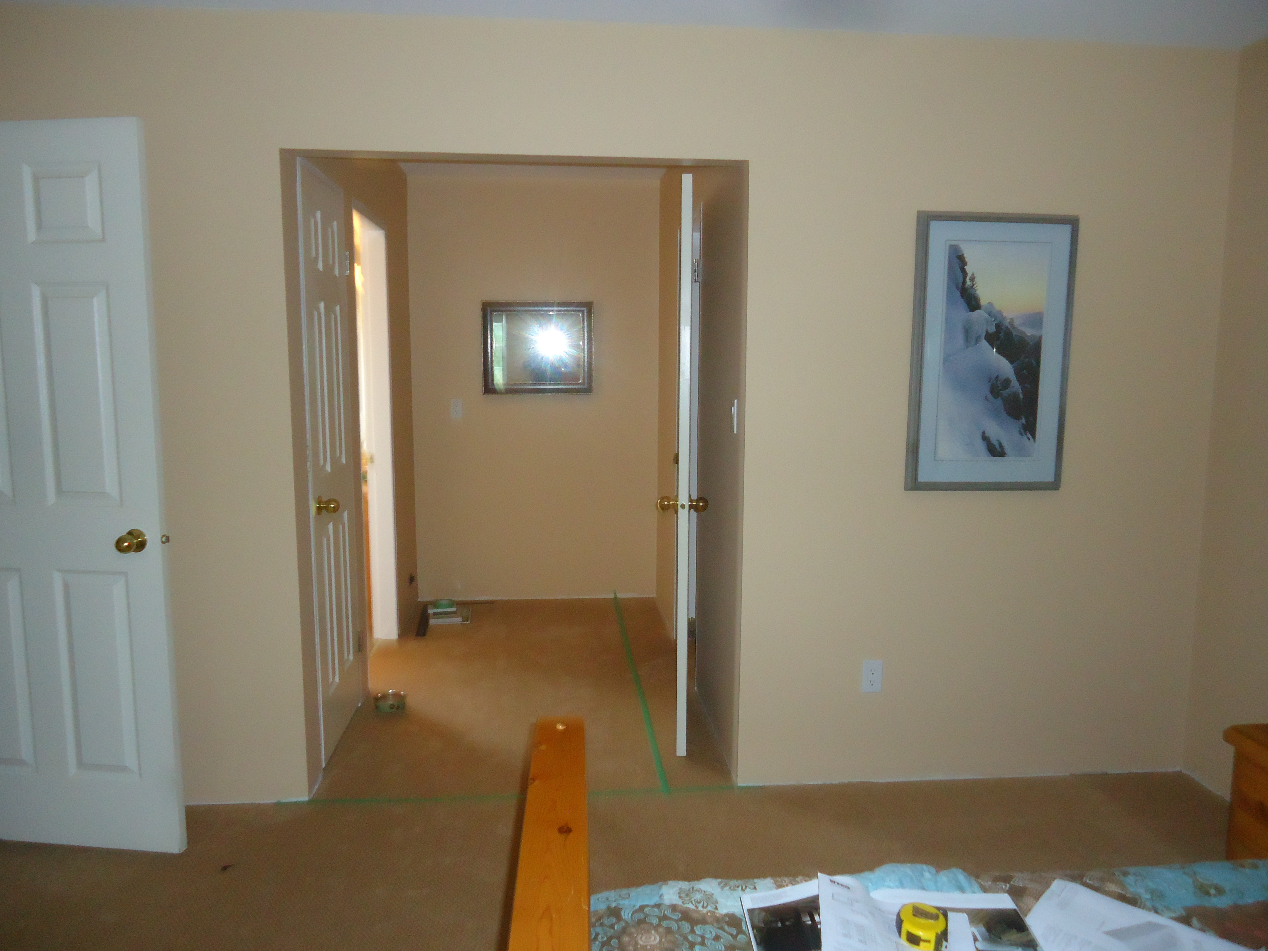 Between the door to the bathroom on the left and the door to our closet on the right, there is a vanity area. On our original house plans it showed an area ...